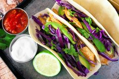 Spicy fish tacos with red cabbage slaw, overhead view Stock Photo