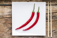 Spicy food with chopstick on white square dish Stock Photography