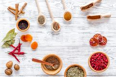 Spicy food cooking with spices and dry herbs light wooden kitchen desk background top view mockup Stock Photos