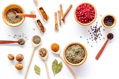 Spicy food cooking with spices and dry herbs white kitchen desk background top view pattern Stock Photo