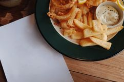 Spicy french fries with dip cream cheese royalty free stock photography