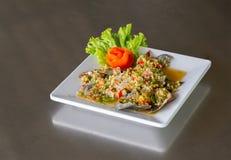 Spicy fresh crab salad on white dish, seafood. OK stock photo