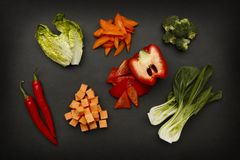 Spicy and fresh, and raw  ingredients for delicious cuisine. Shot on a dark slate background Royalty Free Stock Images