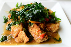 Spicy fried chicken with basil leaves Royalty Free Stock Photo