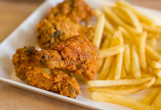 Spicy fried chicken with french fries Stock Photos