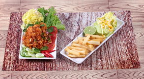 Spicy fried chicken salad (Yum Kai Zap in Thai). As spicy chicken salad,chili,tomato,red onion,roasted rice,dried chili ,Chinese cabbage,lettuce,peppermint Royalty Free Stock Photos