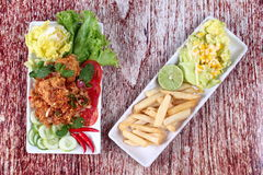 Spicy fried chicken salad (Yum Kai Zap in Thai). As spicy chicken salad,chili,tomato,red onion,roasted rice,dried chili ,Chinese cabbage,lettuce,peppermint Royalty Free Stock Images