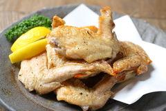 Spicy fried chicken wings with lemon and cumin on platter Stock Images