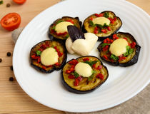Spicy fried eggplant slices with red pepper, garlic, herbs and mozzarella Stock Images