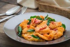 Spicy fried fish with basil (Pad kra prao pla), Thai food Stock Image