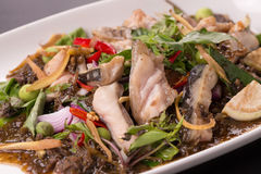 Spicy fried fish on dish, Thai traditional.  stock image