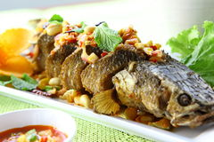 Spicy fried fish head. Stock Photos
