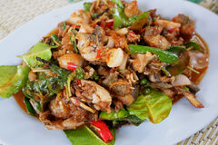 Spicy fried frog. With herbal fried vegetables stock photos