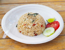 Spicy fried rice on recycled plate. Thai fast food style. Royalty Free Stock Photo