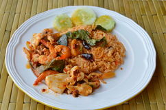 Spicy fried rice with seafood Tom yam on dish. Spicy fried rice with seafood Tom yam on white dish Stock Photos
