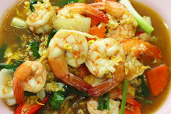 Spicy fried seafood, shrimp, squid. Royalty Free Stock Image