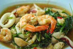 Spicy fried seafood, shrimp, squid. Royalty Free Stock Images