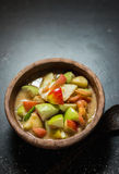 Spicy fruit salad. Thai food spicy fruit salad on black table background stock images