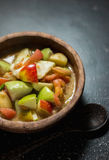 Spicy fruit salad. Thai food spicy fruit salad on black table background stock image