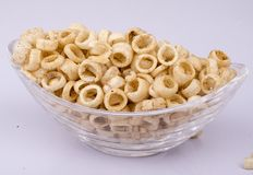 Spicy fryums or snacks, or corn rings in glass bowl Royalty Free Stock Photography