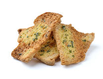 Spicy garlic and parsley crackers. On white background stock photos
