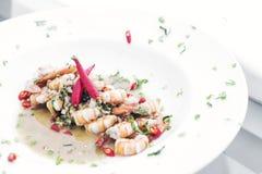 Spicy garlic prawns modern fusion gourmet food cuisine meal. Spicy garlic and wine prawns modern fusion gourmet food cuisine meal royalty free stock images