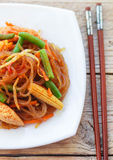 Spicy glass noodles with chicken, green beans, carrots, corn and soy sprouts Stock Image