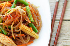 Spicy glass noodles with chicken, green beans, carrots, corn and soy sprouts Royalty Free Stock Image