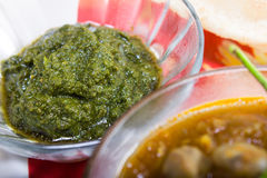 Spicy green chutney, indian dish concept Stock Photo