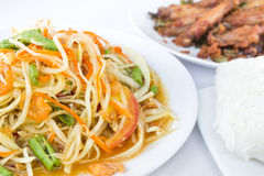 Spicy green papaya salad. With fried chicken and rice,  Thai cuis  Thai cuisine Royalty Free Stock Photos