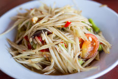 Spicy green papaya salad. And roast chicken. Traditional Lao dish known in Thailand as Som Tam Royalty Free Stock Image