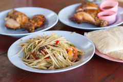 Spicy green papaya salad. And roast chicken. Traditional Lao dish known in Thailand as Som Tam Royalty Free Stock Photo