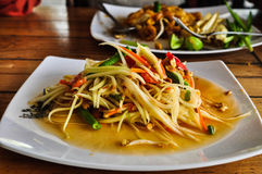 Spicy Green papaya salad (somtam). Famous Thai food Royalty Free Stock Photography