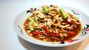 Spicy green papaya salad Somtum in Thai language, Famous traditional Thai food Stock Photography