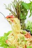 Spicy green papaya salad or Somtum on white background, Thai foo. Closeup of Green Papaya salad or Somtum with pickled crab on white background. Famous Thai Royalty Free Stock Images