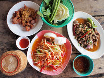 Spicy green papaya salad, spicy duck salad, fried pork. (traditional thai food stock image