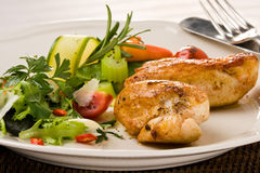 Spicy grilled chicken breast. Dinner set of spicy grilled chicken breast with herbs and salad Royalty Free Stock Photography
