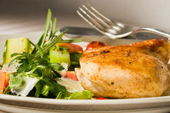 Spicy grilled chicken breast. With herbs and salad Stock Photography