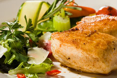 Spicy grilled chicken breast stake with celery. Spicy grilled chicken breast with celery Stock Images