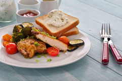 Spicy grilled chicken breast with vegetables Stock Image