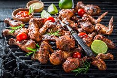 Spicy grilled chicken leg on metal grate Stock Images