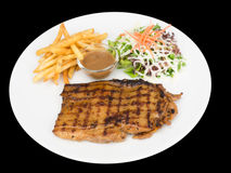 Spicy Grilled chicken steak served with french fries and salads Royalty Free Stock Image