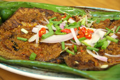 Spicy grilled fish stock image