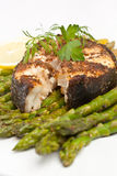 Spicy grilled halibut fish with asparagus Stock Image