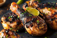 Spicy Grilled Jerk Chicken. With Lime and Spices Royalty Free Stock Images