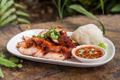 Spicy grilled pork and sticky rice stock image