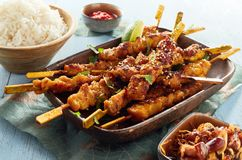 Spicy grilled satay skewers with fluffy white rice royalty free stock photos