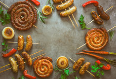 Spicy grilled sausages background royalty free stock images
