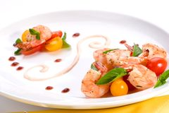 Spicy grilled shrimps and basi Stock Photos