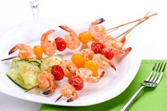 Spicy grilled shrimps and basil tomato salad Royalty Free Stock Photography